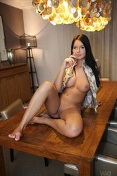 Nice Boobed Babe Nude On The Table