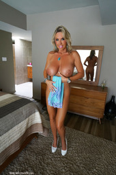 Busty MILF Strips And Masturbates